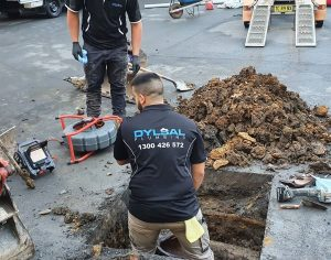 Plumber fixing a blocked drain